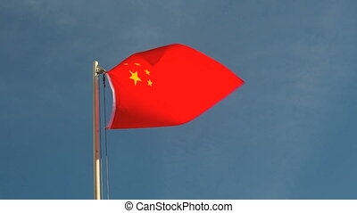 China flag in slow motion in front of blue sky
