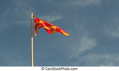 Macedonia flag in slow motion in front of a blue sky