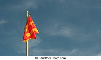 Request Macedonia flag in front of a blue sky