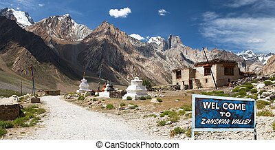 Village in Suru valley and signpost Welcome to Zanskar...