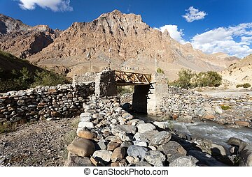 bridge with prayer flags on Zanskar trek, Ladakh - woody and...