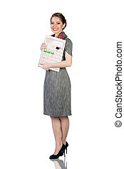 Business woman with a big calculator
