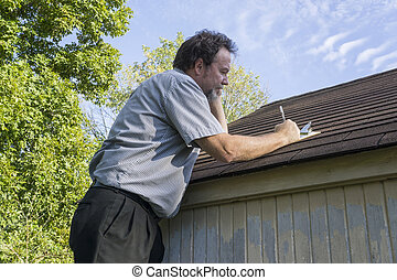 Insurance Adjuster On Cell Phone Calculating Roof Repair Costs