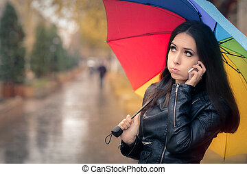 Autumn Girl with Unbrella and Phone - Cute girl wearing...