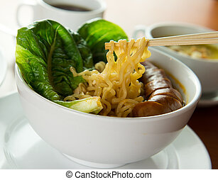 Korean noodles soup - Closeup of Korean noodle soup served...