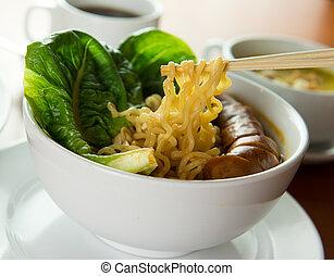 Korean noodles soup - Closeup of Korean noodle soup served...
