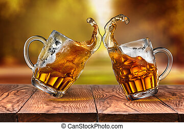 Beer in glasses with splash on wooden table against autumn leave