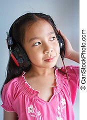 Little girl listening to music. - beautiful little girl in...