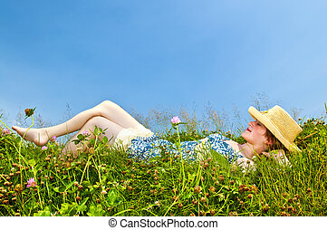Young girl laying in meadow - Young teenage girl laying...