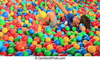 Boy in a ball pool