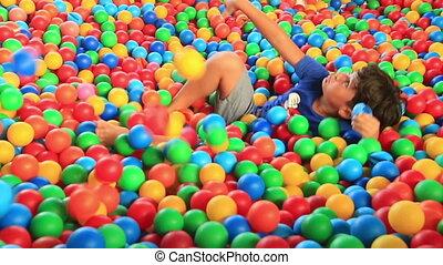 Boy  in a ball pool