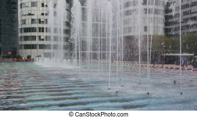 Close up view at playing fountains near La Grande Arche in...