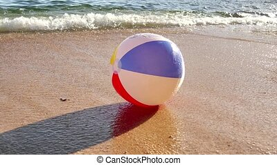 Beach Ball at the Mercy of Waves - The sea dragging a beach...