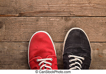 Colorful shoes on wood - Colorful shoes on a rustic wooden...
