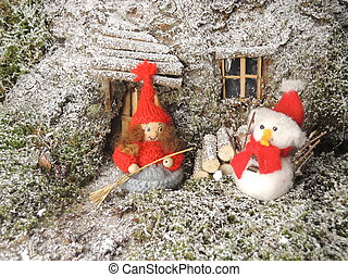 Christmas card - gnome in front of  cosy home in the forest