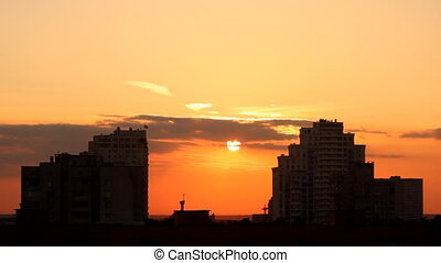 sunset in the city - sunset between two large buildings