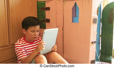 Boy using ipad - Young boy gaming on tablet computer