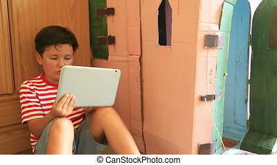 Boy using i pad - Young boy gaming on tablet computer