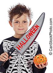 Beautiful boy dressed of skeleton in Halloween