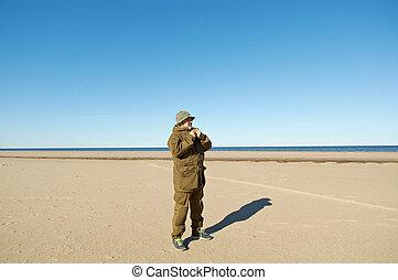 White Sea Russia, - traveler on the beachWhite Sea Russia,...