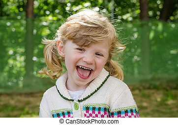 happy blond girl laughing - happy beautiful blond girl...