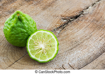 Kaffir Lime (Bergamot). - Kaffir Lime (Bergamot) on wood...