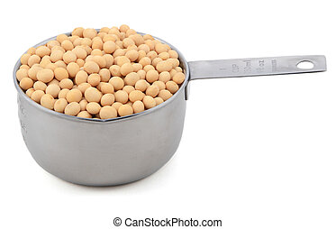 Soybeans, or soya beans, in a measuring cup - Soybeans, or...