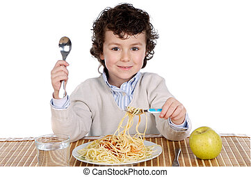 Precious child eating spaghetti on a white background