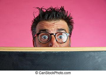 Nerd man crazy behind blackboard funny gesture - Nerd man...