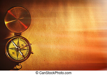 Antique brass compass over old background - Antique brass...
