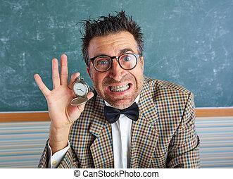 Nerd silly teacher showing vintage chain watch in green...