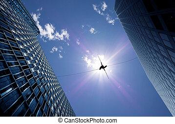 Highline walker on the rope low-angle shot - Highline walker...