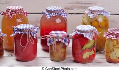 Canned foods - Glass jars with canned vegetables and fruits...