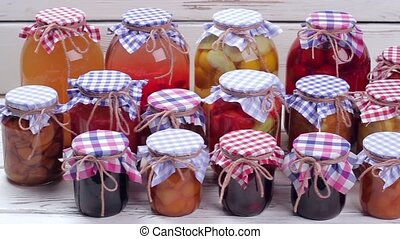 Glass jars with canned food. Beautiful glass jars of...