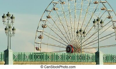 Classical Fair Ferris Wheel - Ferris wheel on the banks of...