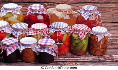 Storing of canned foods. Many glass jars with conservation.