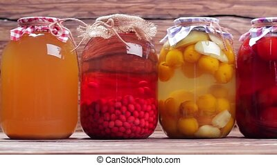 Organic compotes. Canned fruit drinks in glass jars....