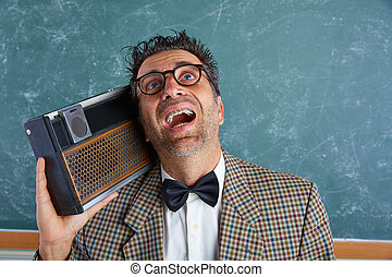 Nerd silly retro man with braces and vintage radio - Nerd...
