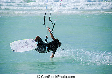 A kitesurfer displaying his skills in the sport