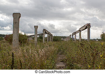 Lost city. Abandoned farm. Concrete posts. Ruins.