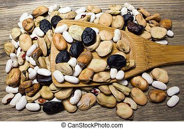 mixed beans with wooden spoon