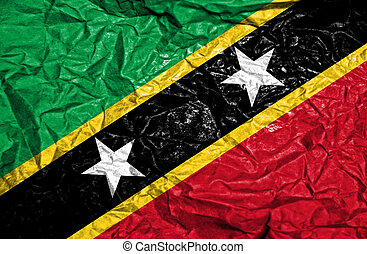 St Kitts and Nevis vintage flag on old crumpled paper...