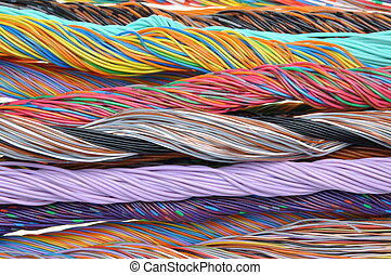 Multicolored telecommunication cables isolated on white...