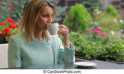 Drinking coffee in cafe