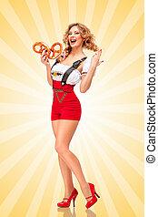 Yummy pretzels - Beautiful sexy Oktoberfest woman wearing...