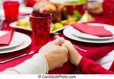 close up of family christmas dinner at home - family,...