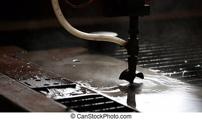 View process of cutting metal with water and sand - Close-up...