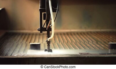 Waterjet cutting metal View of modern machine, close-up