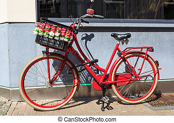 Red bicycle in Belgium - Red bicycle in the city of Antwerp,...