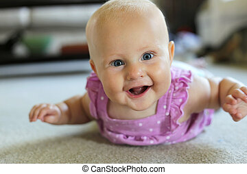 Happy 6 Month old Baby Girl Learning to Crawl - A happy 6...